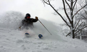 photo of backcountry skier at caberfae peaks